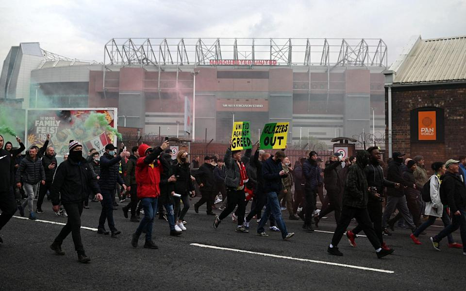 Demonstrators protest against Manchester United's owners outside Old Trafford stadium i - AFP
