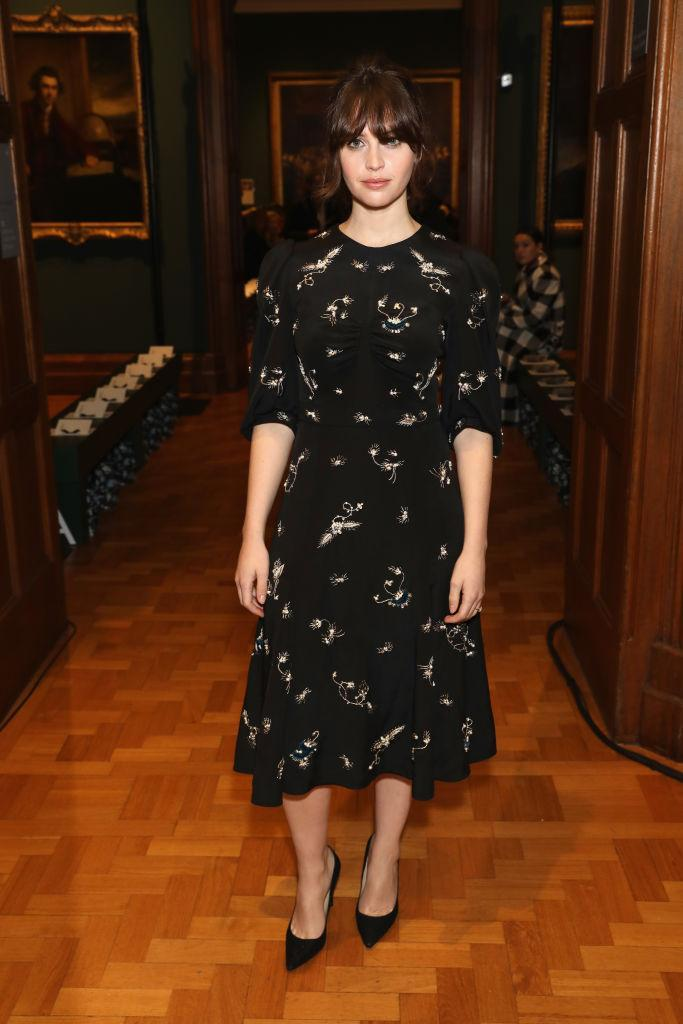 <p>Felicity Jones opted for a dainty dress by the label for the AW18 preview. <em>[Photo: Getty]</em> </p>