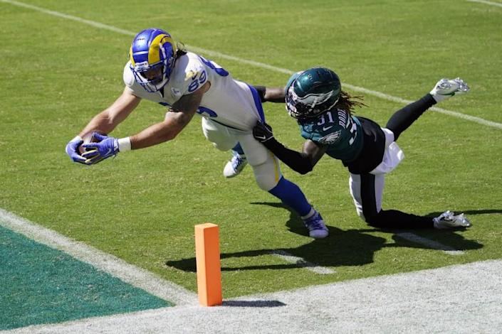 Los Angeles Rams' Tyler Higbee, left, reaches for a touchdown against Philadelphia Eagles' Nickell Robey-Coleman.