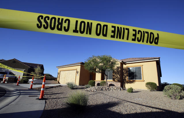 Police tape blocks off the home of Stephen Paddock on Oct. 2, 2017, in Mesquite, Nev. Paddock killed dozens and injured hundreds on Oct. 1 when he opened fire at an outdoor country music festival in Las Vegas. Heavily armed police searched Paddock's home Monday. (Photo: Chris Carlson/AP)