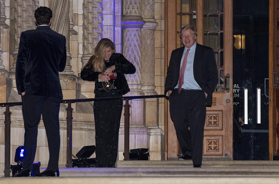 LONDON, ENGLAND - FEBRUARY 07:  Foreign Secretary Boris Johnson passes Carrie Symonds as he leaves the Conservative party Black and White Ball at Natural History Museum on February 7, 2018 in London, England. The ball is a fundraising event for the political party where donors pay to spend the evening with cabinet ministers and the Prime Minister.  (Photo by Chris J Ratcliffe/Getty Images)