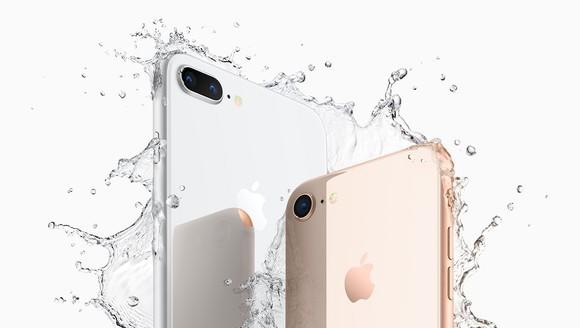 Apple's iPhone 8 Plus and iPhone 8 shown being splashed with water.