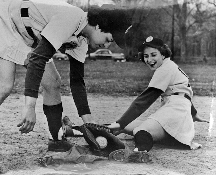 In this undated provided by the Center for History, Racine Belles' Sophie Kurys slides as Belles teammate Betty Trezza applies the tag. Kurys, who stole 201 bases in 1946 while playing in the All American Girls Professional Baseball League, has died. She was 87. The AAGPBL Players Association said Wednesday, Feb. 20, 2013, that she died Sunday, Feb. 17, after complications from surgery. (AP Photo/Courtesy of Center for History)