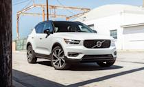 """<p>Excitement is important and the <a href=""""https://www.caranddriver.com/volvo/xc40"""" rel=""""nofollow noopener"""" target=""""_blank"""" data-ylk=""""slk:Volvo XC40"""" class=""""link rapid-noclick-resp"""">Volvo XC40</a> is like the guy at the party who showed up just to cannonball into the pool from the roof. Compared to what others in this segment offer, or don't, the Volvo is extra. The base price is reasonable, you can choose a contrasting roof color, and the available Lava carpeting is crazy in a good way. A 184-hp turbocharged inline-four and front-wheel drive is standard, while all-wheel-drive models get a power boost to 248 horsepower. An eight-speed automatic is standard. The XC40's 3500-pound towing capacity is an unexpected plus in this segment, too. To make the most out of its size, there are a number of nooks and crannies to store phones, books, magazine, garbage, or takeout boxes. A 9.0-inch infotainment touchscreen is on every model, and is mostly a replacement for physical buttons and knobs. The XC40 is also one of nine 2021 Volvo <a href=""""https://www.caranddriver.com/features/g15086429/safest-suv/"""" rel=""""nofollow noopener"""" target=""""_blank"""" data-ylk=""""slk:models with an IIHS Top Safety Pick+ award"""" class=""""link rapid-noclick-resp"""">models with an IIHS Top Safety Pick+ award</a>.</p><ul><li>Base price: $34,795</li><li>EPA Fuel Economy combined/city/highway: 26/23/32 mpg (FWD)</li><li>Rear cargo space: 20 cubic feet</li></ul><p><a class=""""link rapid-noclick-resp"""" href=""""https://www.caranddriver.com/volvo/xc40/specs"""" rel=""""nofollow noopener"""" target=""""_blank"""" data-ylk=""""slk:MORE XC40 SPECS"""">MORE XC40 SPECS</a></p>"""