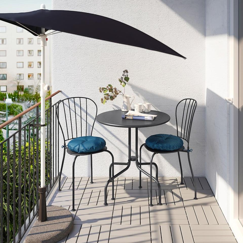 """<p>Add a little romance to your balcony with the <a href=""""https://www.popsugar.com/buy/L%C3%A4ck%C3%B6-Table-Two-Chairs-580757?p_name=L%C3%A4ck%C3%B6%20Table%20and%20Two%20Chairs&retailer=ikea.com&pid=580757&price=97&evar1=casa%3Aus&evar9=46226851&evar98=https%3A%2F%2Fwww.popsugar.com%2Fhome%2Fphoto-gallery%2F46226851%2Fimage%2F47540414%2FL%C3%A4ck%C3%B6-Table-Two-Chairs&list1=shopping%2Cfurniture%2Cikea%2Csummer%2Csmall%20space%20living%2Chome%20shopping&prop13=api&pdata=1"""" class=""""link rapid-noclick-resp"""" rel=""""nofollow noopener"""" target=""""_blank"""" data-ylk=""""slk:Läckö Table and Two Chairs"""">Läckö Table and Two Chairs </a> ($97).</p>"""