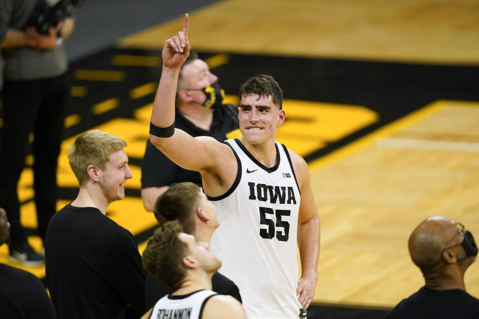 FILE - Iowa center Luka Garza (55) reacts during a video tribute following an NCAA college basketball game against Penn State in Iowa City, Iowa, in this Sunday, Feb. 21, 2021, file photo. Iowas Luka Garza is The Associated Press mens basketball player of the year for the Atlantic Coast Conference and a member of The AP All-Big Ten first team announced Tuesday, March 9, 2021. (AP Photo/Charlie Neibergall, File)