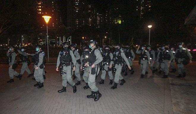 Officers in riot gear arrive to escort the suspects to police vehicles. Photo: Handout