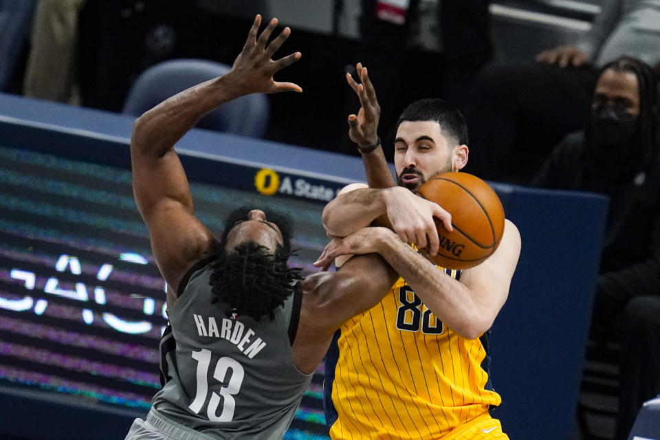 Indiana Pacers center Goga Bitadze (88) fouls Brooklyn Nets guard James Harden (13) during the first half of an NBA basketball game in Indianapolis, Wednesday, March 17, 2021. (AP Photo/Michael Conroy)