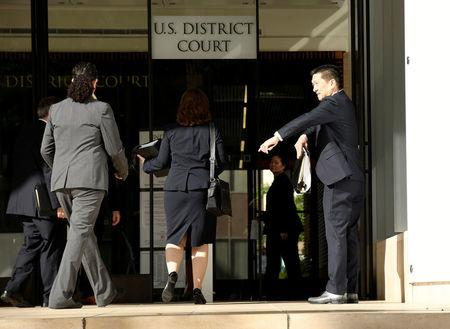 FILE PHOTO - Hawaii Attorney General Douglas Chin arrives at the U.S. District Court Ninth Circuit in Honolulu