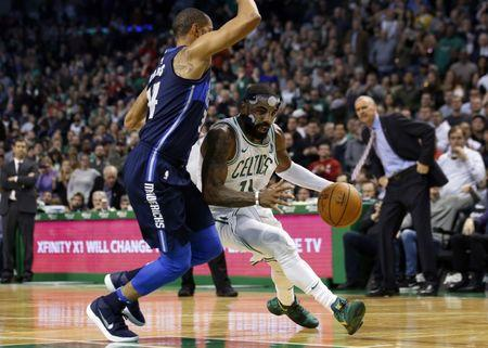 Dec 6, 2017; Boston, MA, USA; Boston Celtics guard Kyrie Irving (11) drives against Dallas Mavericks guard Devin Harris (34) during the fourth quarter of a 97-90 Boston victory at TD Garden. Mandatory Credit: Winslow Townson-USA TODAY Sports