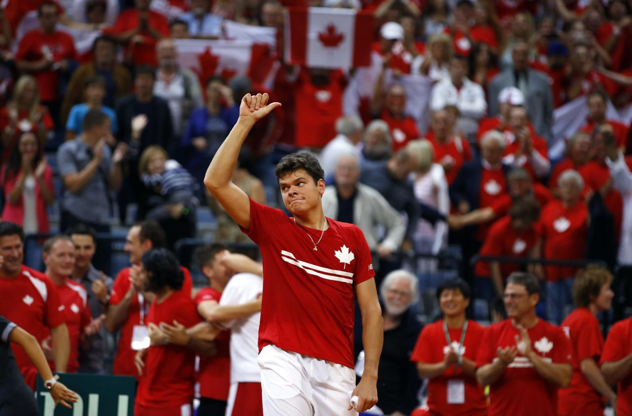 Canada's Milos Raonic celebrates his victory over Serbia's Janko Tipsarevic after their Davis Cup semi-final tennis match in Belgrade September 13, 2013. REUTERS/Marko Djurica (SERBIA - Tags: SPORT TENNIS)