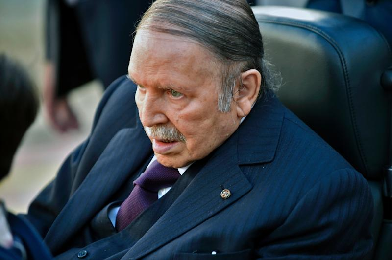 Algerian President Abdelaziz Bouteflika is seen heading to vote at a polling station in Algiers on November 23, 2017 as Algeria goes to the polls for local elections