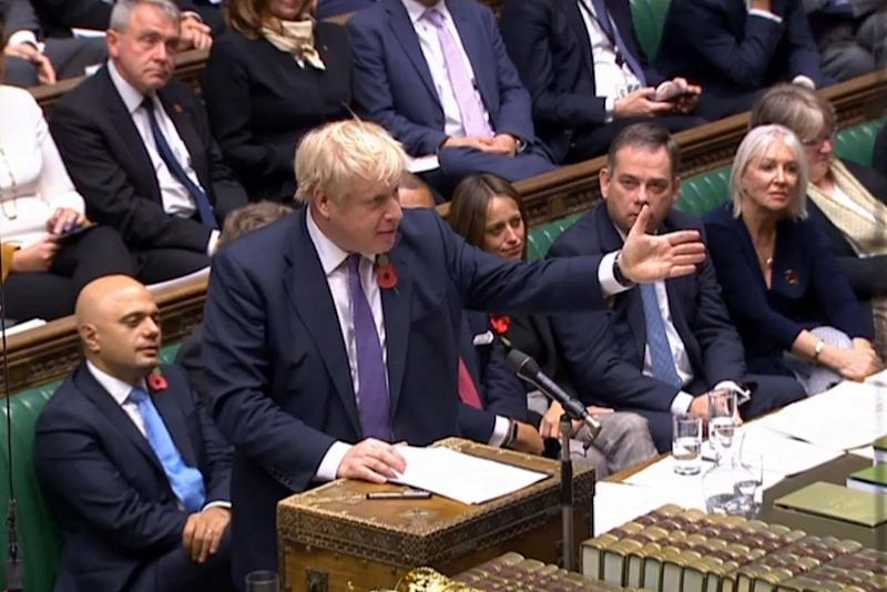 Boris Johnson standing and speaking at the beginning of a debate (PRU/AFP via Getty Images)