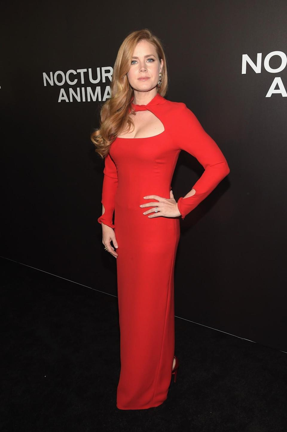<p>Naturally, Amy was wearing a gorgeous red Tom Ford gown for the premiere of the film directed by the designer. <i>[Photo: Getty]</i> </p>
