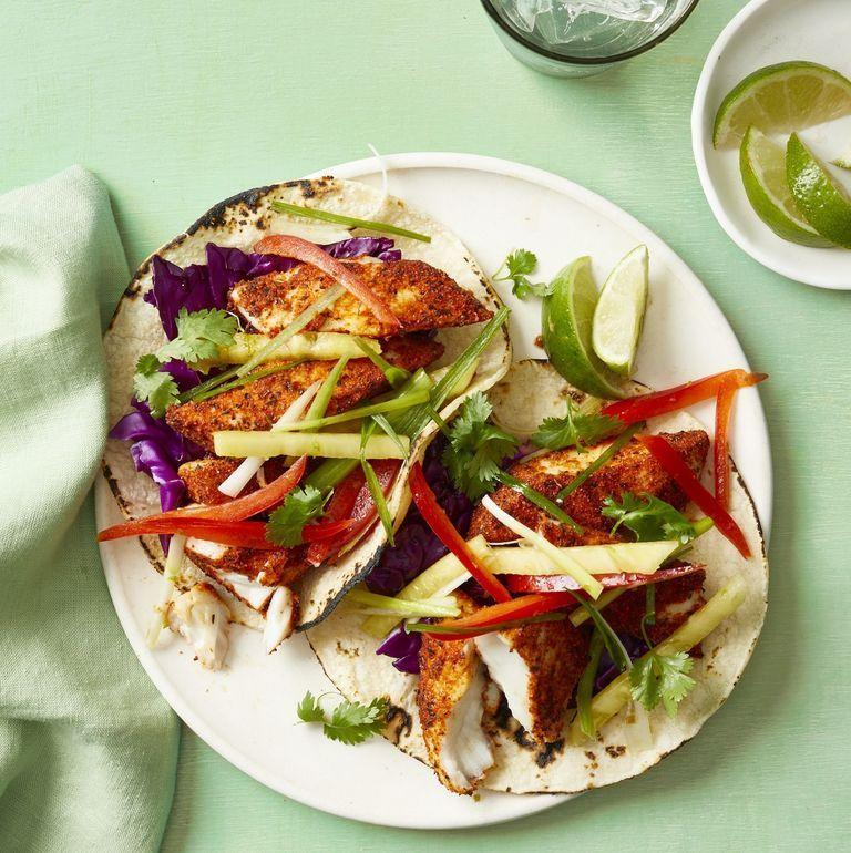 """<p>The secret ingredient to this quick and easy lunch is super=spice Cajun seasoning. It creates a bold flavor that you'll want to add to all of your meals from here on out. <br></p><p><em><a href=""""https://www.womansday.com/food-recipes/a31981535/blackened-fish-tacos-recipe/"""" rel=""""nofollow noopener"""" target=""""_blank"""" data-ylk=""""slk:Get the Blackened Fish Tacos recipe."""" class=""""link rapid-noclick-resp"""">Get the Blackened Fish Tacos recipe.</a></em></p>"""