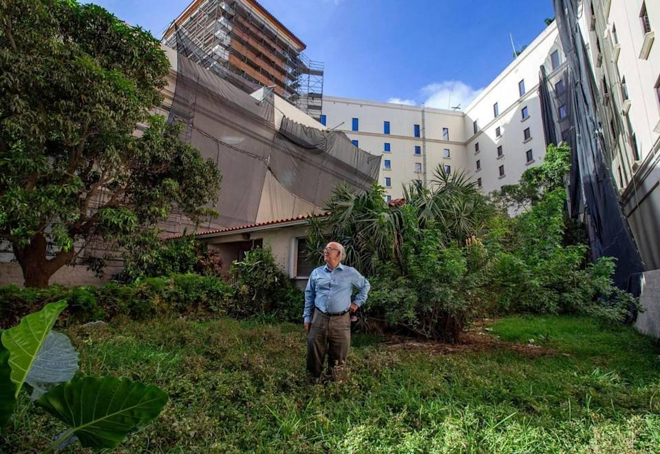 """Orlando Capote's house is surrounded by The Plaza Coral Gables, the biggest development in Coral Gables history. """"This house was our American dream,"""" Capote said."""