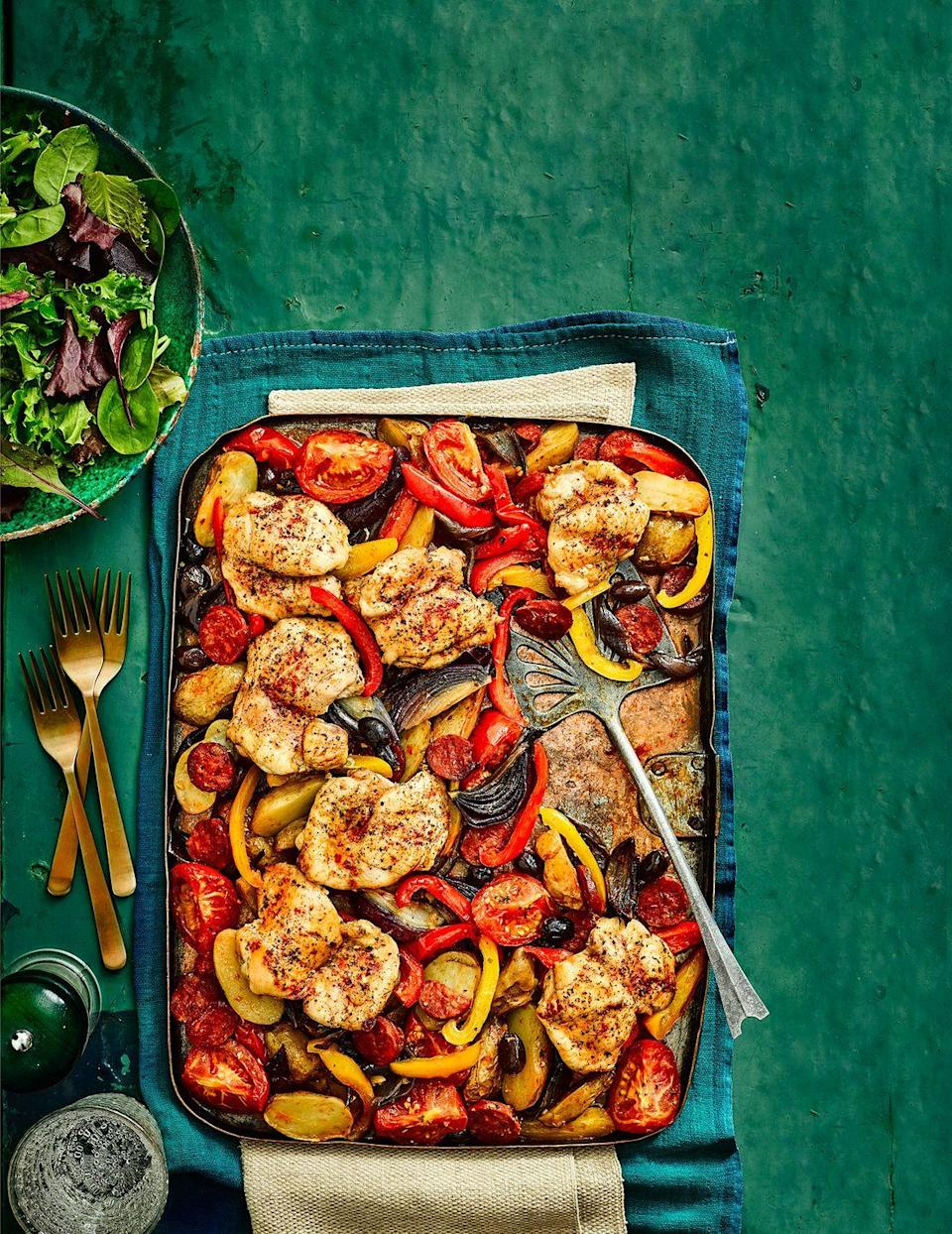 """<p>A chicken traybake full of sunshine flavours. If you'd prefer not to use sherry, substitute with chicken stock instead.</p><p><strong>Recipe: <a href=""""https://www.goodhousekeeping.com/uk/food/recipes/a24427190/chicken-traybake/"""" rel=""""nofollow noopener"""" target=""""_blank"""" data-ylk=""""slk:Spanish chicken tray bake"""" class=""""link rapid-noclick-resp"""">Spanish chicken tray bake</a></strong></p>"""