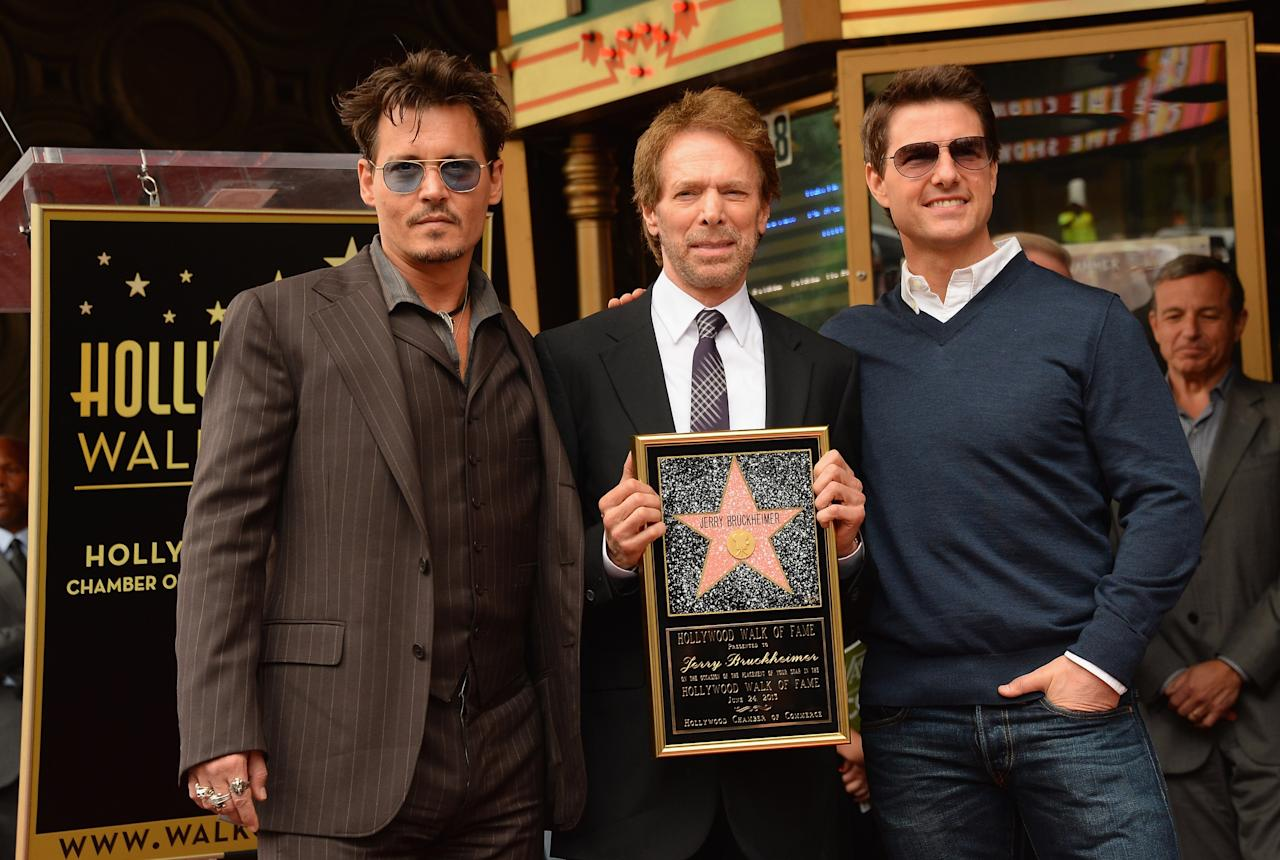HOLLYWOOD, CA - JUNE 24: (L-R) Johnny Depp, Jerry Bruckheimer and Tom Cruise pose as Jerry Bruckheimer is honored on the Hollywood Walk Of Fame on June 24, 2013 in Hollywood, California. (Photo by Mark Davis/Getty Images)