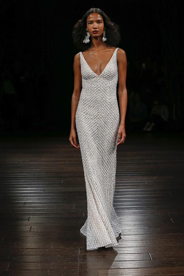 """<p>This simplistic caviar beaded gown, known as Sunset by <a rel=""""nofollow"""" href=""""http://www.brides.com/gallery/new-naeem-khan-wedding-dresses-2017-fall?mbid=synd_yahoostyle"""">Naeem Khan</a>, carries notes of grace and elegance. A clean sheath silhouette lets the silver beaded diagonal stripes do all the talking, a perfect expert in metallic making a statement without being overbearing.</p>"""