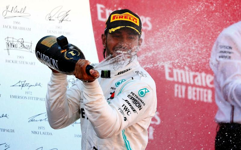 Lewis Hamilton won his third race of the year to retake the championship lead in Spain - REUTERS