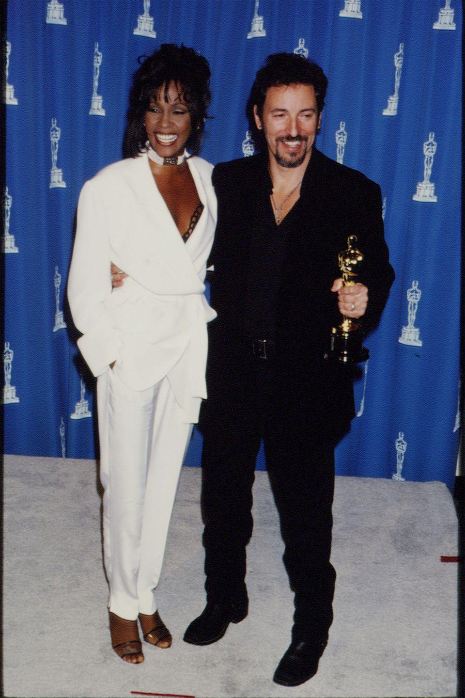 <p>Whitney Houston attended the '94 Oscars as a presenter, standing out in a sea of beautiful gowns in louche white suiting. </p>