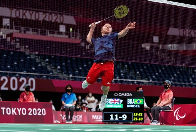 Great Britain's Krysten Coombs jumps for a smash in his badminton bronze medal match