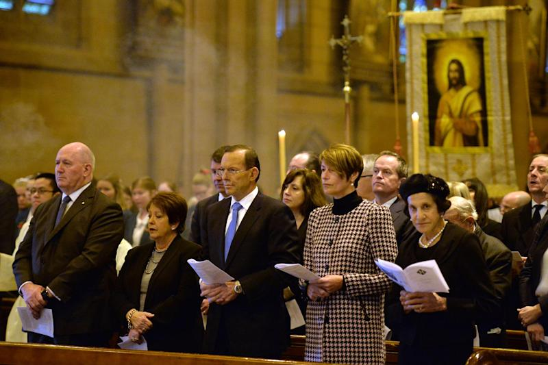 Australian Prime Minister Tony Abbott (C) and his wife Margaret attend a service for victims of Flight MH17 with Peter Cosgrove (L), Governor-General of the Commonwealth of Australia, at St. Mary's Catherdral in Sydney on July 20, 2014