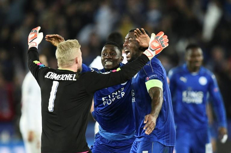 Leicester City's Danish goalkeeper Kasper Schmeichel (L) celebrates with teammates at the final whistle of their match match against Sevilla at the King Power Stadium on March 14, 2017