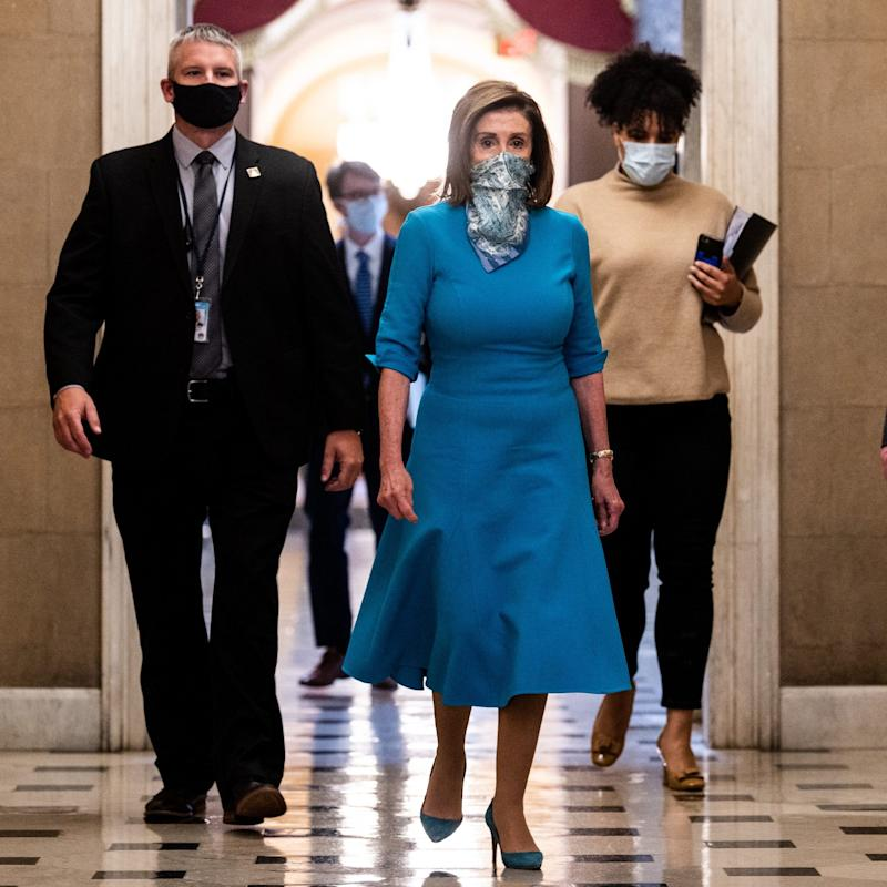 Nancy Pelosi blue face mask - Michael Brochstein / Echoes Wire/Barcroft Media via Getty Images