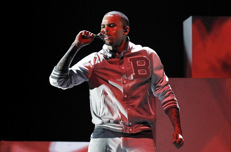 FILE - In this Feb. 12, 2012 file photo, Chris Brown performs during the 54th annual Grammy Awards, in Los Angeles. Brown returns to a Los Angeles court on Wednesday, Feb. 6, 2013, for a hearing in which prosecutors want a judge to revoke his probation and order him to re-do his community labor because of concerns about the accuracy of records provided by Virginia authorities. Brown remains on probation for the 2009 beating of Rihanna. (AP Photo/Matt Sayles, File)