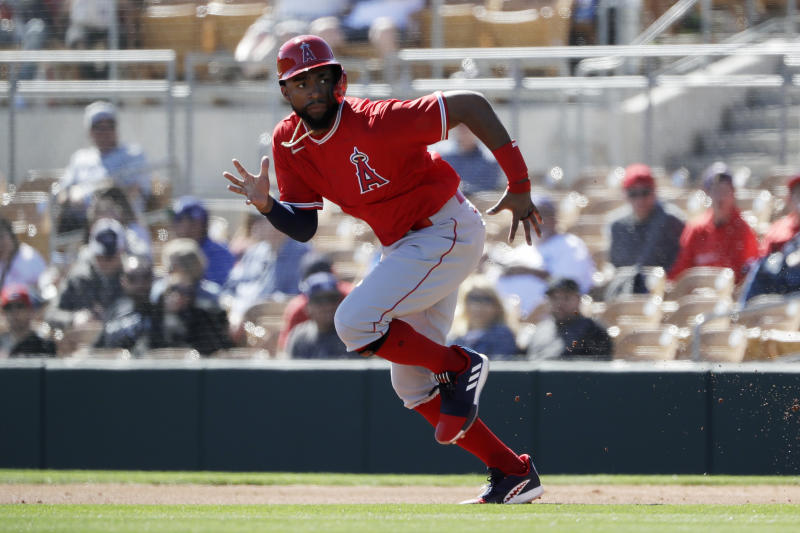 Los Angeles Angels' Jo Adell runs towards second base before getting out on a force out by Brian Goodwin during the first inning of a spring training baseball game against the Los Angeles Dodgers, Wednesday, Feb. 26, 2020, in Glendale, Ariz. (AP Photo/Gregory Bull)