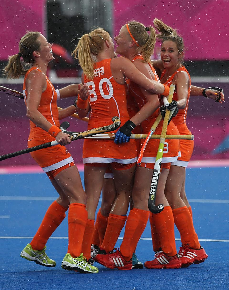 LONDON, ENGLAND - JULY 29: Caia Van Maasakker of Netherlands celebrates scoring her team's third goal with her team mates during the Women's Pool WA Match W02 between the Netherlands and Belgium at the Hockey Centre on July 29, 2012 in London, England. (Photo by Daniel Berehulak/Getty Images)
