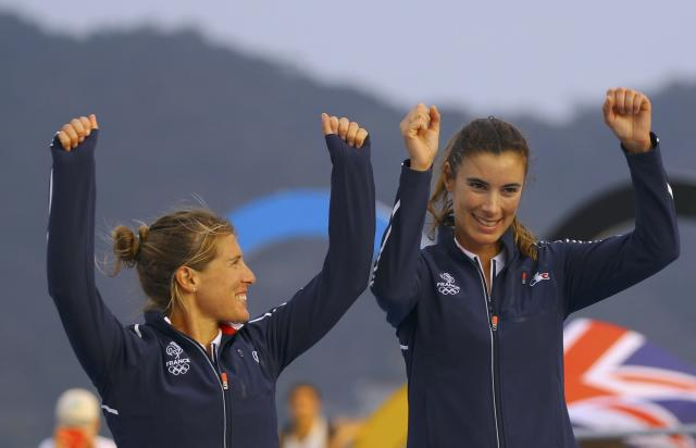 2016 Rio Olympics - Sailing - Victory Ceremony - Women's Two Person Dinghy - 470 - Victory Ceremony - Marina de Gloria - Rio de Janeiro, Brazil - 18/08/2016. Camille Lecointre (FRA) of France and Helene Defrance (FRA) of France celebrate bronze medal. REUTERS/Brian Snyder FOR EDITORIAL USE ONLY. NOT FOR SALE FOR MARKETING OR ADVERTISING CAMPAIGNS.