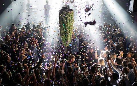 <span>A depiction of a cannabis bud drops from the ceiling at Leafly's countdown party in Toronto on Wednesday</span> <span>Credit:  Chris Young </span>