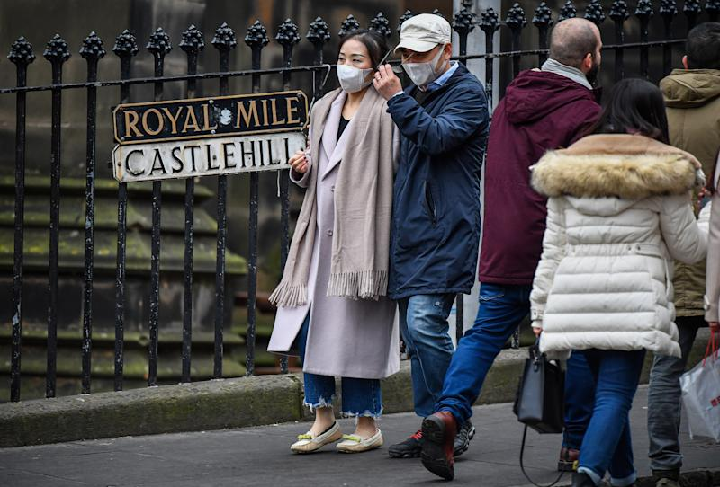 EDINBURGH, SCOTLAND - JANUARY 24: Tourists wear face masks as they visit Edinburgh Castle on January 24, 2020 in Edinburgh, Scotland. It has been confirmed that 14 people in Scotland with symptoms have tested negative for the coronavirus, which has killed at least 26 people in China. A daily incident management team has been created by the Scottish government to monitor the developing situation. (Photo by Jeff J Mitchell/Getty Images)