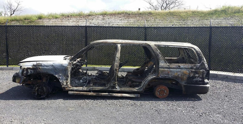 This undated photo released by the Maui Police Department shows the driver's side view of a vehicle belonging to missing pregnant woman Carly Scott. Scott's mother reported her missing Monday, 10, 2014. She told police a family member last saw the 27-year-old redhead Sunday night at her sister's home in Haiku, in northeast Maui. (AP Photo/Maui Police Department)