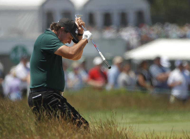 Phil Mickelson reacts to a shot from the fescue on the fifth hole during the third round of the U.S. Open. More
