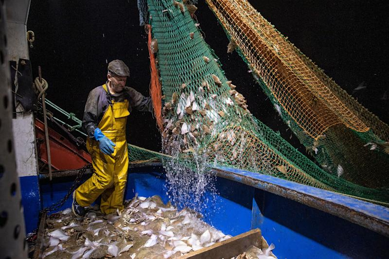 Fishermen work in the English Channel, off the coast of Hastings. (Photo: Dan Kitwood via Getty Images)