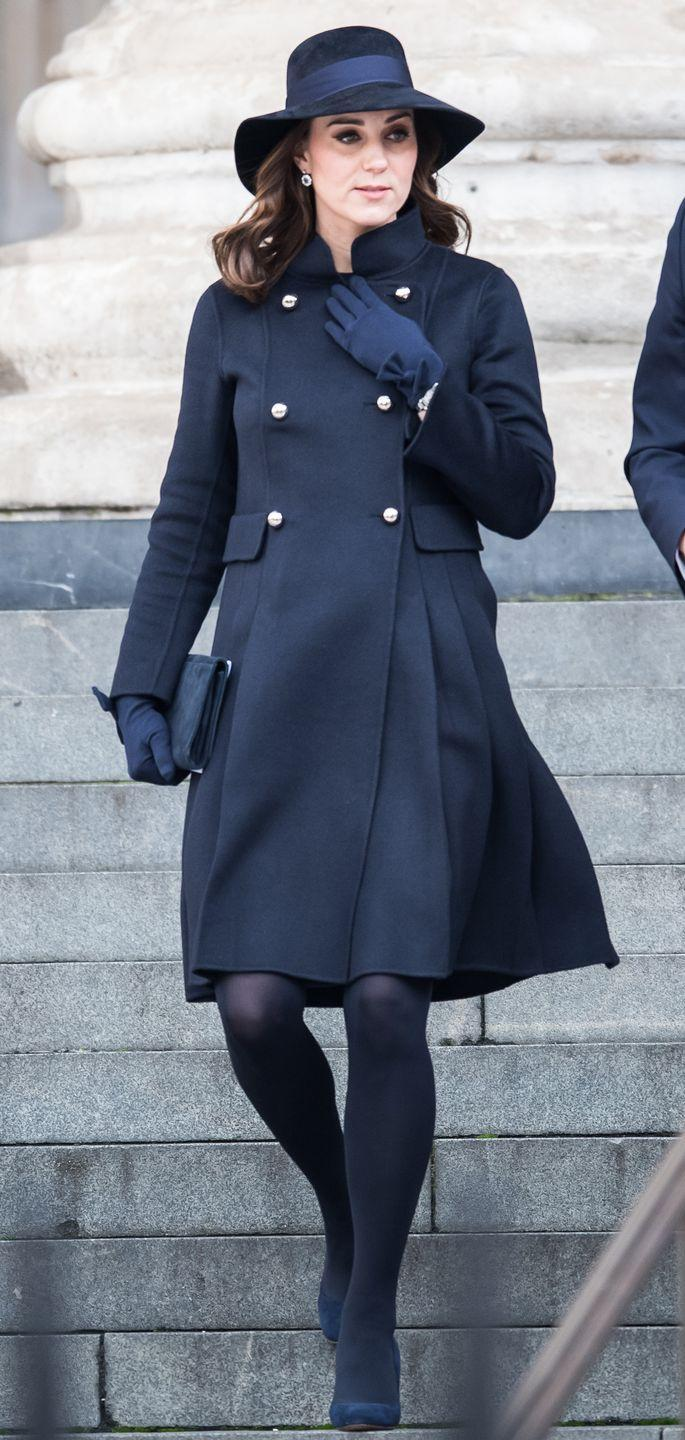 <p>The Duchess wore a CH Carolina Herrera double-breasted coat, LK Bennett clutch, tights, navy pumps, bow-detailed gloves, and a suede hat at a memorial for victims of the Grenfell Tower fire.</p>