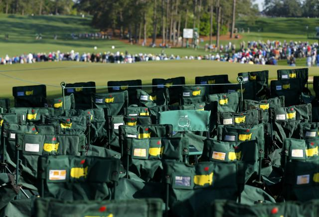 Masters chairs are arranged around the seventh green during the second round of the Masters golf tournament at the Augusta National Golf Club in Augusta, Georgia April 11, 2014. REUTERS/Mike Blake (UNITED STATES - Tags: SPORT GOLF)