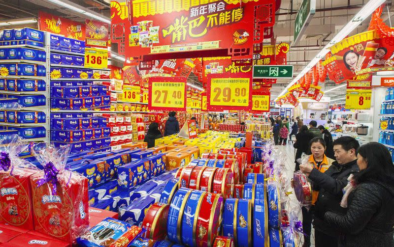 Customers select goods at a supermarket in Lianyungang, Jiangsu province