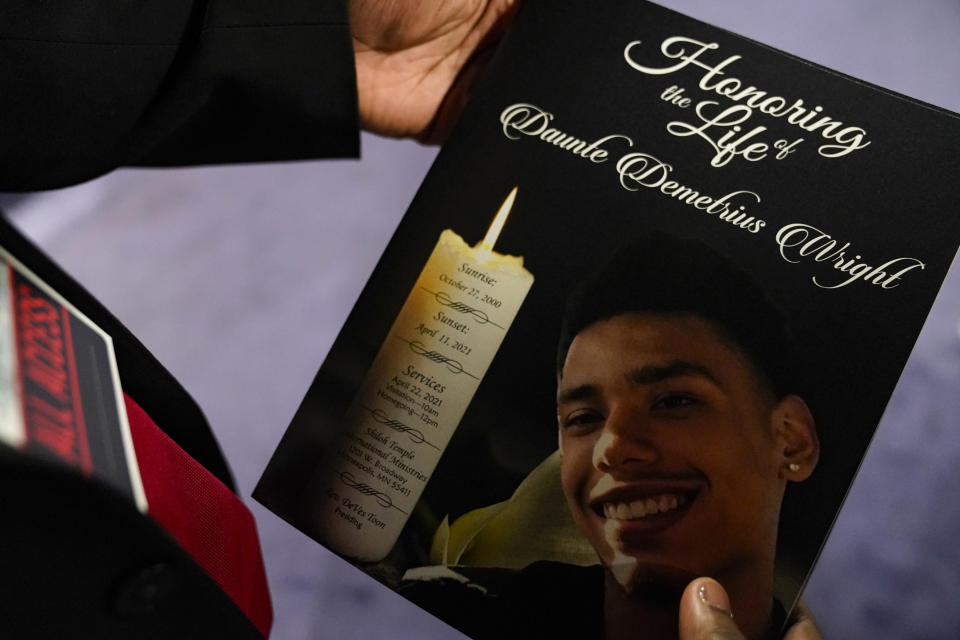 This April 22, 2021 file photo shows a mourner holding the program for the funeral services of Daunte Wright at Shiloh Temple International Ministries in Minneapolis. Minnesota Attorney General Keith Ellison says his office will lead the prosecution of former Brooklyn Center Officer Kim Potter who is charged with second-degree manslaughter in the death of Daunte Wright. Potter, who is white, fatally shot Wright, a 20-year-old Black motorist, on April 11, 2021. (AP Photo/John Minchillo, Pool, File)
