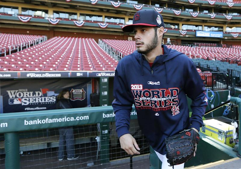 St. Louis Cardinals pitcher Joe Kelly walks out of the dugout before a baseball practice, Friday, Oct. 25, 2013, in St. Louis. The St. Louis Cardinals and Boston Red Sox are set to play Game 3 of the World Series on Saturday in St. Louis. (AP Photo/Charlie Neibergall)