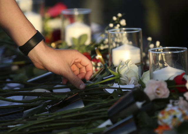 <p>People place flowers in honor for the victims of the Santa Fe High School shooting during a vigil at Texas First Bank Friday, May 18, 2018, in Santa Fe, Texas. (Photo: Godofredo A. Vasquez/Houston Chronicle via AP) </p>
