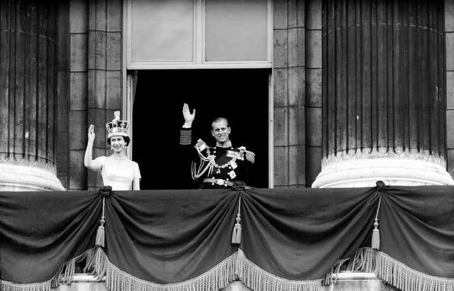 The Queen and the Duke of Edinburgh on the balcony of Buckingham Palace after her coronation (PA)