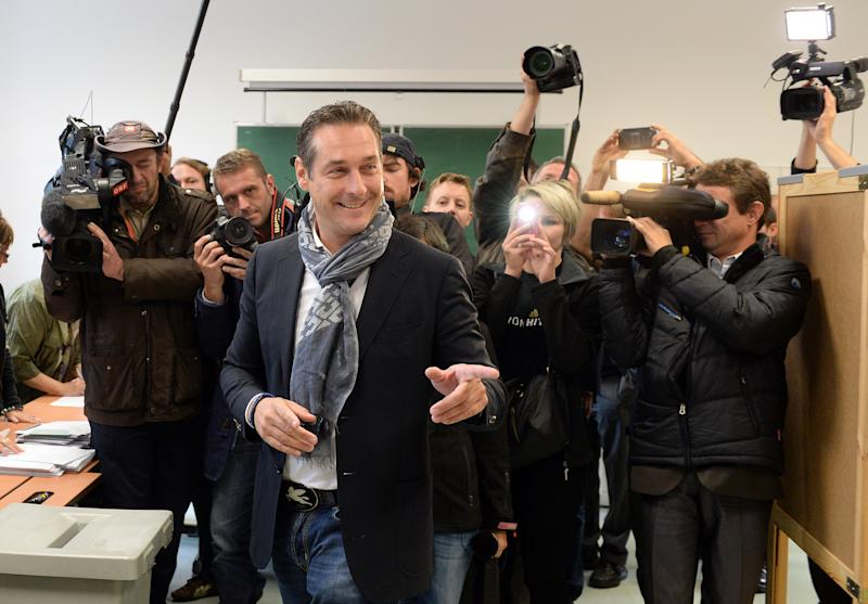 Top candidate of the Freedom Party, FPOE, Heinz-Christian Strache, casts his vote in national elections at a polling station in Vienna, Austria, Sunday, Sept. 29, 2013. Austrians went to the polls to elect a new parliament. (AP Photo/Kerstin Joensson)