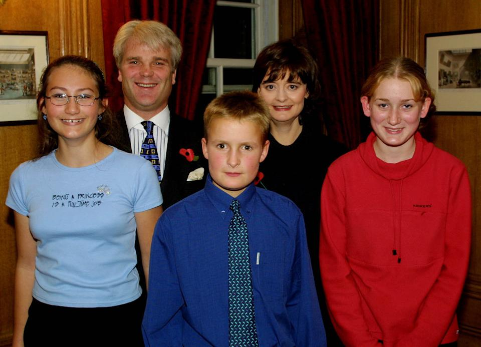 Left to right: Kirsty Bonham, MP for New Forest West Desmond Swayne, Edward Morris and Megan Sharp, pose for photos with the British Prime Minister's wife, Cherie Blair, during a tea party at Downing Street.