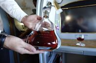 <p>After finishing a couple of flutes, I decided to have an early morning drink of Hennessy Paradis cognac, the most expensive drink in the sky. A standard bottle retails for over $700. <i>(Photo: Sam Huang)</i><br></p>