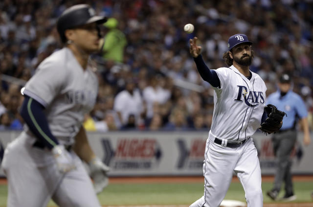 Tampa Bay Rays pitcher Chaz Roe, right, throws out New York Yankees' Giancarlo Stanton on a ground ball back to the mound during the seventh inning of a baseball game Friday, June 22, 2018, in St. Petersburg, Fla. (AP Photo/Chris O'Meara)