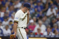 Milwaukee Brewers starting pitcher Aaron Ashby reacts after walking a Chicago Cubs batter during the first inning of a baseball game Wednesday, June 30, 2021, in Milwaukee. (AP Photo/Jeffrey Phelps)
